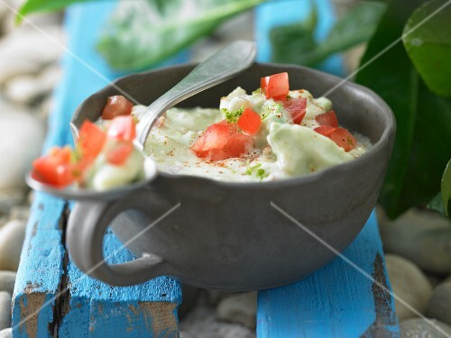 Avocado dip with diced tomato