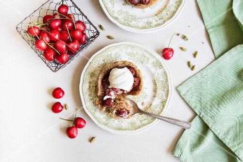 Cherry tart with whipped cardamom cream