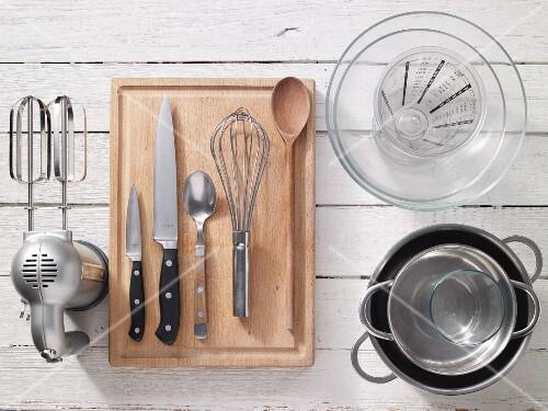 Kitchen utensils for preparing rhubarb compote with vanilla cream