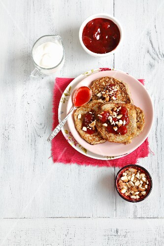 Couscous pancakes with bananas, strawberry jam and almonds