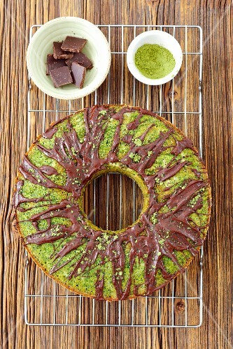 Sweet spinach cake with matcha tea and chocolate glaze