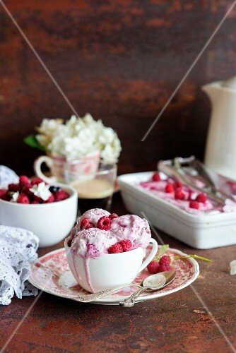 Three scoops of home-made raspberry ice cream in a cup