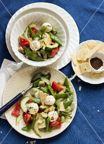 Fattoush salad with broad beans, tomato, cucumber, labneh cheese and pita bread