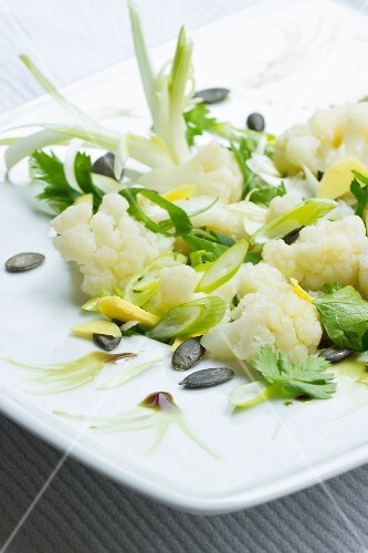 Cauliflower salad with fresh ginger, pumpkin seeds, spring onions and pumpkin seed oil