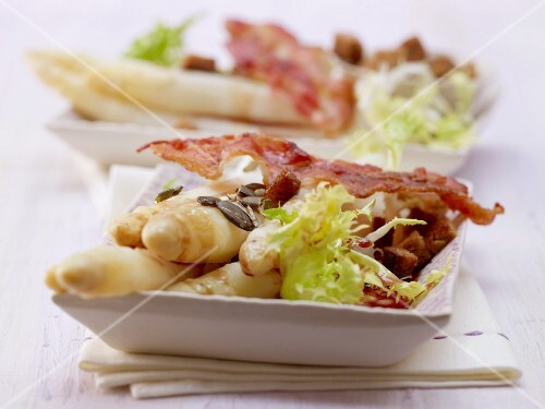 An asparagus and frissee lettuce salad with bacon