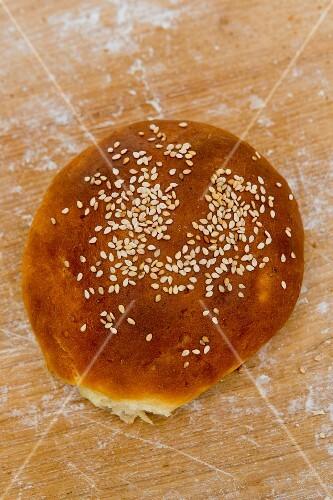 A potato bun on a floury surface