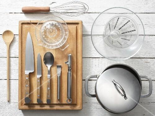 Kitchen utensils for preparing orange couscous with vegetable salad