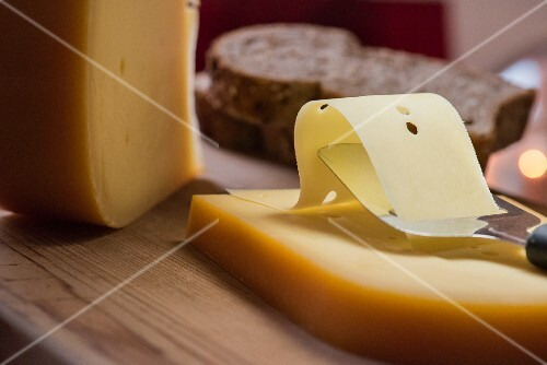 Semi-hard cheese with a cheese slicer