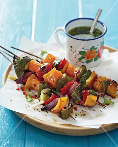 Grilled vegetable kebabs with herb oil