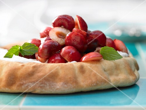 Yeast dough topped with quark and cherries