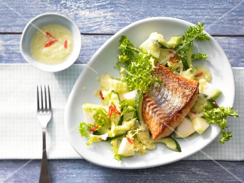 Frisee lettuce and melon salad with pan-fried pike-perch fillet