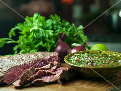 A flank steak with chimichurri (Argentina)