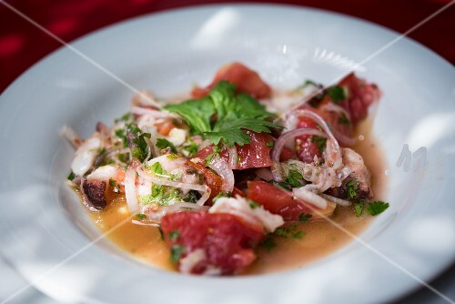 Octopus salad with tomatoes and herbs