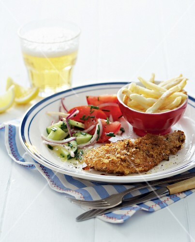 Chicken escalope in Parmesan breadcrumbs with vegetable salad and chips
