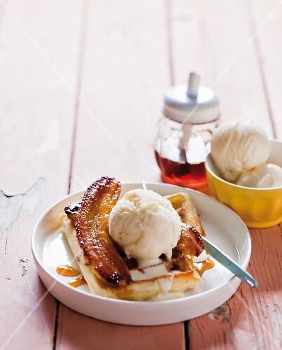 Waffles with flambéed bananas and vanilla ice cream