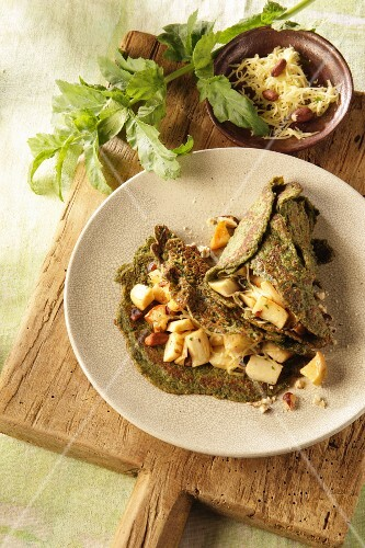 Herb pancakes with parsnip and hazelnuts