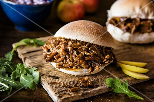 A pulled pork burger with apple and salad