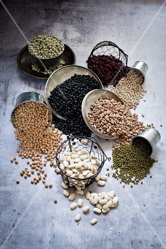 Various types of beans in containers
