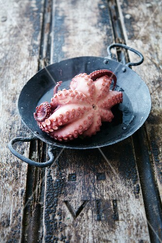 Boiled octopus in a cast iron pan