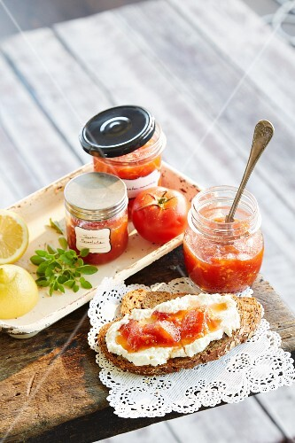 Tomato jam in jars and on bread