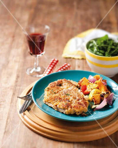 A minute steak with a lemon & Parmesan coating served with pan-fried vegetables