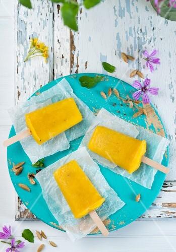 Vegan mango & cardamom ice lollies