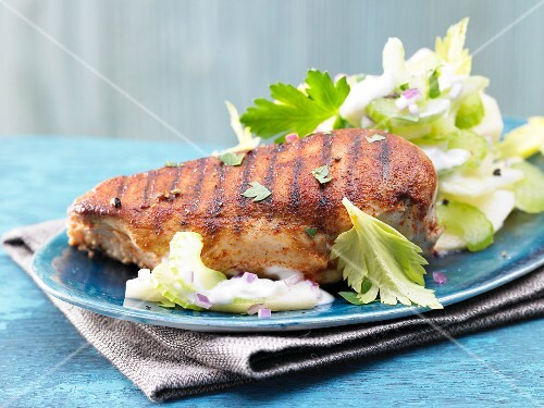 Spicy chicken breats on a bed of apple and celery salad