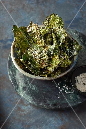 Kale crisps with sea salt in a bowl