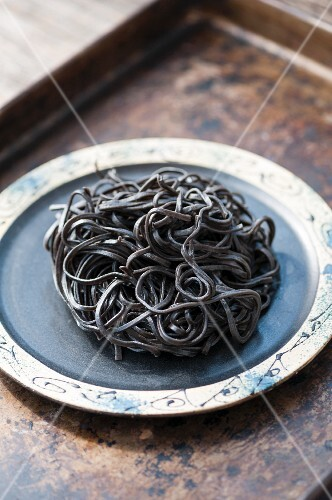 Black squid ink pasta on a plate