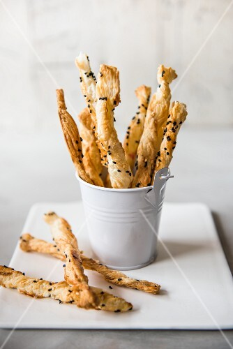 Savoury puff pastry straws in a mini bucket