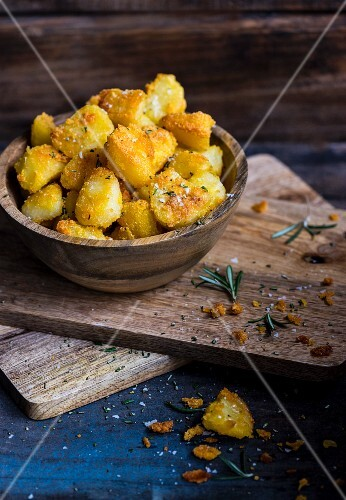 Roast potatoes with a polenta crust, Parmesan and rosemary