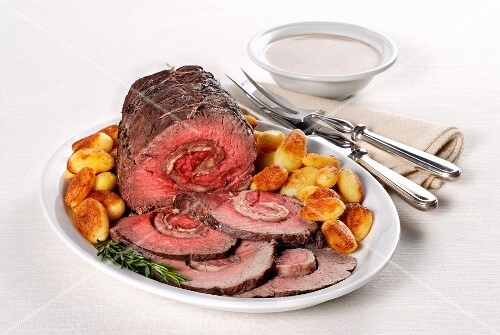 Arrosto rosa di parma (rolled roast beef with a ham filling, Italy)