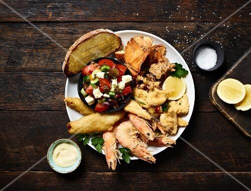 Fritto misto with seafood and Greek salad