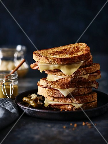 A stack of cheese & ham toasted sandwiches