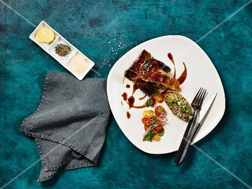 Shoulder of lamb with prosciutto and barley risotto