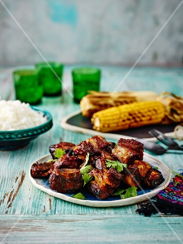 Beef ribs with grilled corn on the cob (Mexico)