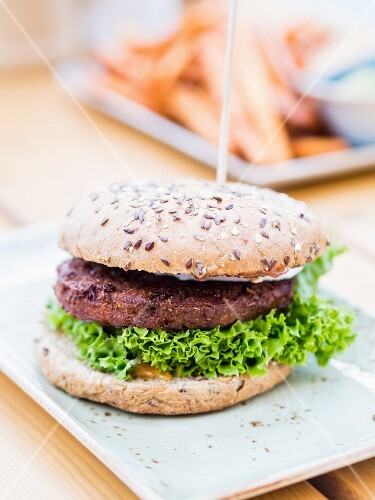A vegetarian burger in a wholemeal bun