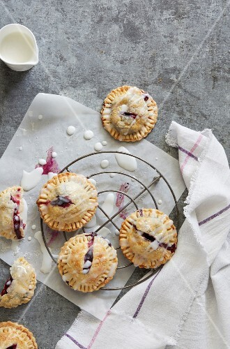 Hand pies with a berry filling on a cooling rack