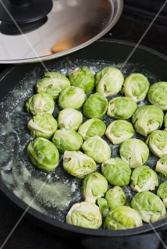 Brussels sprouts being fried in butter