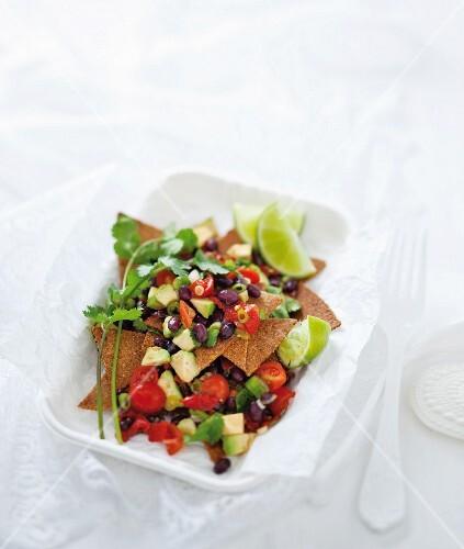 A superfood snack: home-made nachos with bean & avocado salsa