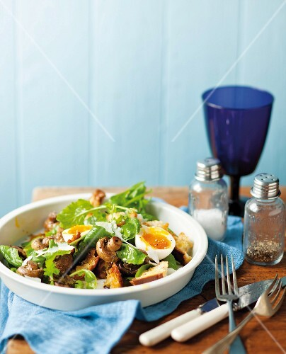 Mushroom salad with eggs, rocket and croutons