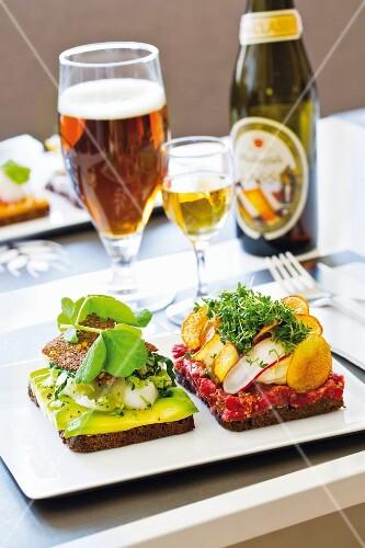 Danish Smörrebröd with tartare and avocado at the restaurant Aamanns in Copenhagen, Denmark