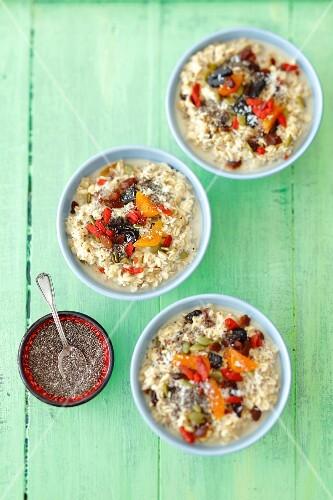 Porridge with dried apricots, goji berries, pumpkin seeds, chia and coconut milk