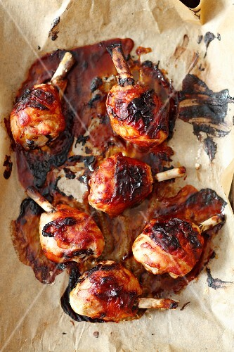 Baked BBQ chicken legs on baking paper