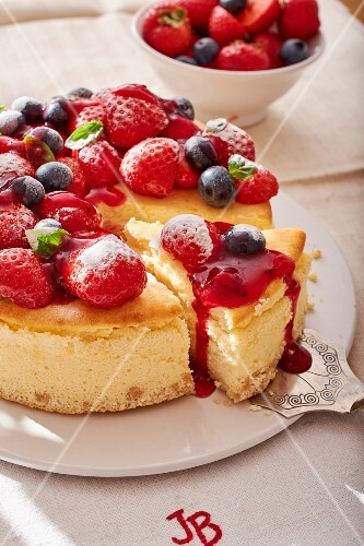 Sliced red berry cheesecake