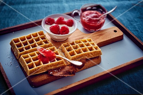Waffles with raspberries and strawberry coulis
