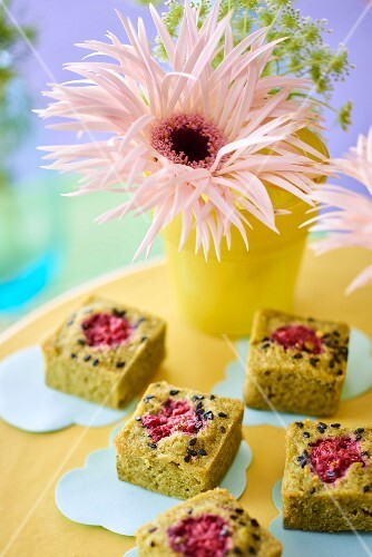 Vase of flowers and financier cakes on wedding buffet table