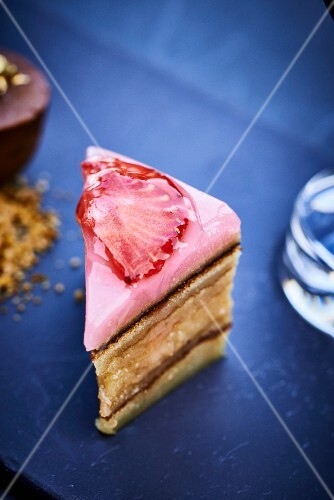 A mini layer cake with strawberry icing