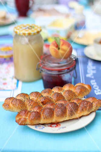 Yeast plaits with poppy seeds on the breakfast table