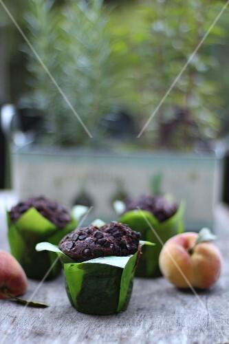 Chocolate muffins and fresh fruits